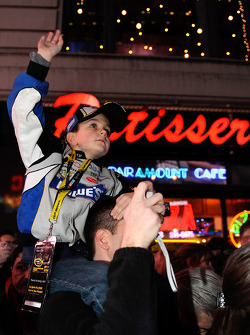 A young Jimmie Johnson fan watches the festivities outside of the Hard Rock Cafe in Times Square