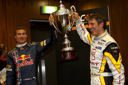 David Coulthard and Jason Plato lift the trophy as a joke