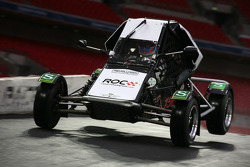 Jenson Button takes off at the jump on the bridge in ax RX150 Buggy
