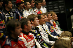 Michael Schumacher and the rest of the drivers pose for a photo