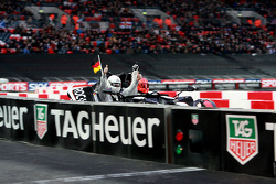 Quarter final, race 7: Michael Schumacher celebrates win