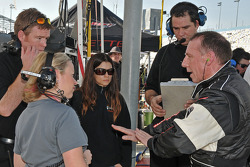 Andy Wallace discusses with Katie Wallace while Danica Patrick looks on