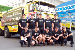 Ales Loprais, Vojtech Stajf and Milan Holan pose with Loprais Tatra team members