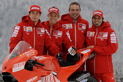 Nicky Hayden, Casey Stoner, Livio Suppo and Vittoriano Guareschi with the new Ducati Desmosedici GP9