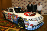 Bobby Labonte, driver of the No. 96 Ask.com Ford poses along side Ask.com CEO Jim Safka, and Hall of Fame Racing co-owner Tom Garfinkel