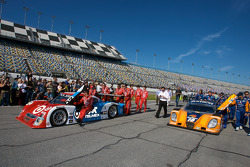 #02 Chip Ganassi Racing with Felix Sabates Lexus Riley and #10 SunTrust Racing Ford Dallara pushed to the starting grid