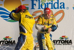GS victory lane: class and overall winners Matthew Bell and Bill Auberlen celebrate