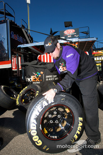 Joe Gibbs Racing Toyota team member prepares wheels