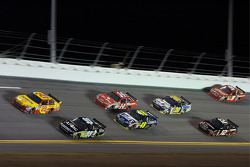 Kevin Harvick, Richard Childress Racing Chevrolet, and Carl Edwards, Roush Fenway Racing Ford, lead a group of cars