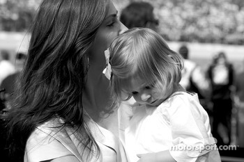 Ingrid Vandebosch, wife of Jeff Gordon, shares a moment with her daughter Ella Sofia on the starting grid