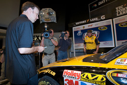 Champion's breakfast: Matt Kenseth, Roush Fenway Racing Ford, signs his 2009 Daytona 500 winning car