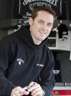 Casey Mears signs autographs at the souvenir hauler