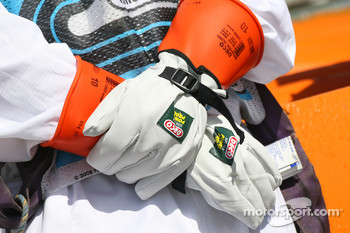 A Marshall wearing protective gloves for KERS