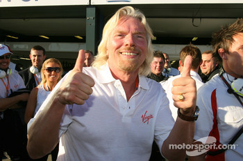 Sir Richard Branson CEO of the Virgin Group celebrates pole position