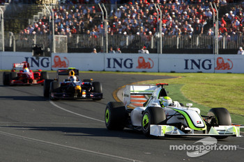 Jenson Button, Brawn GP leads Sebastian Vettel, Red Bull Racing, RB5