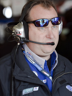 Crew chief Eddie Pardue looks over the Citifinancial Ford