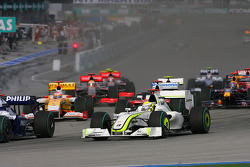 Start: Nico Rosberg, Williams, passes Jenson Button, Brawn GP for the lead