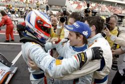Race winners Stefan Mücke and Jan Charouz celebrate