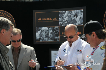 Al Unser Jr. and Bobby Rahal sign autographs