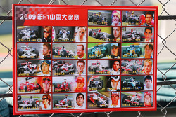 A sign for the marshalls with images and names of the drivers