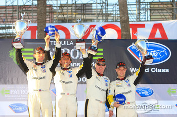 GT1 podium: class winners Olivier Beretta and Oliver Gavin, second place Johnny O'Connell and Jan Magnussen