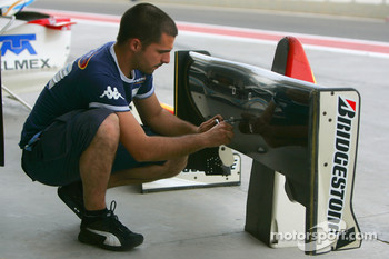 A Barwa International Campos Grand Prix mechanic at work