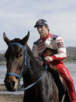 Sébastien Loeb rides a horse