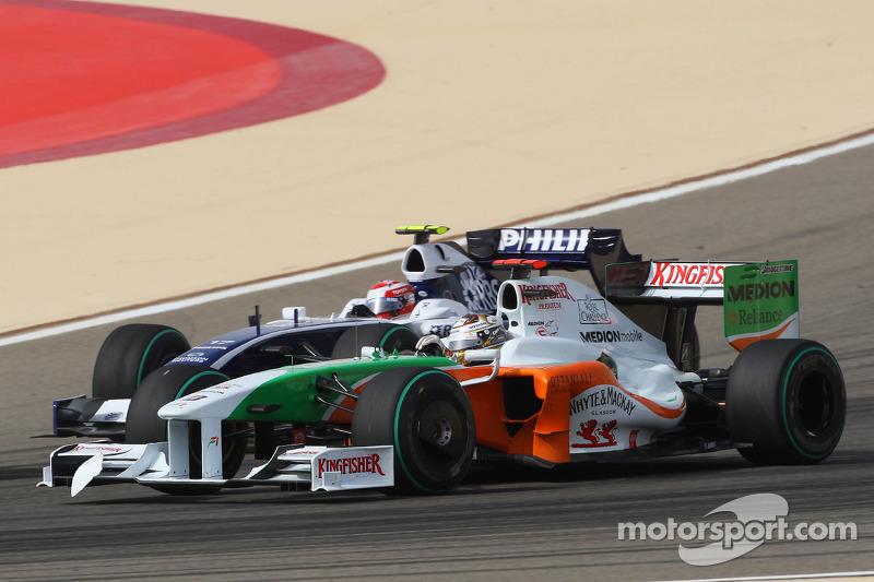 Adrian Sutil, Force India F1 Team and Kazuki Nakajima, Williams F1 Team