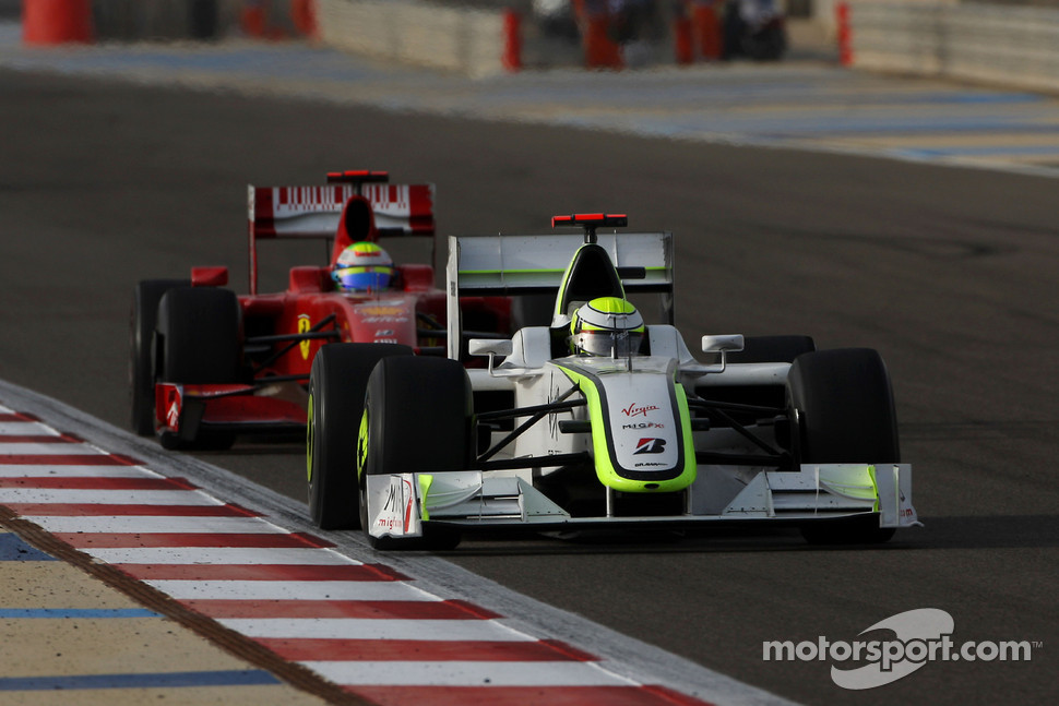 Jenson Button, Brawn GP and Felipe Massa, Scuderia Ferrari