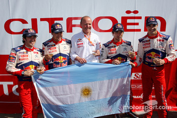 Winners Sbastien Loeb and Daniel Elena, Citroen C4, Citroen Total World Rally Team, second place Daniel Sordo and Marc Marti celebrate with Citroen Total World Rally Team boss Olivier Quesnel