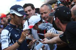 Kazuki Nakajima, Williams F1 Team signing autographs for the fans