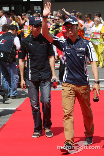 Kazuki Nakajima, Williams F1 Team and Sebastian Vettel, Red Bull Racing