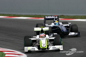 Rubens Barrichello, Brawn GP and Nico Rosberg, Williams F1 Team