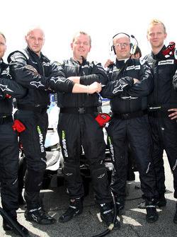 Brawn GP mechanics hiding their rear diffuser