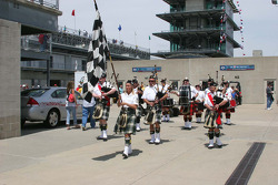 The Gordon Pipers march through the garage area