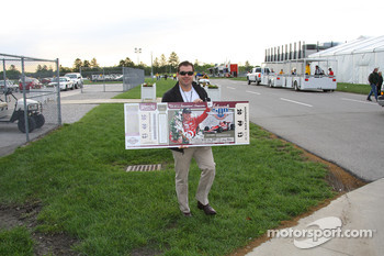 IMS President and COO Joie Chitwood and a replica of the 2009 Indianapolis 500 ticket