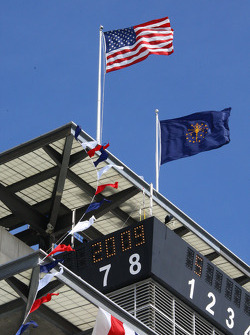 The United States flag and the Indiana state flag fly on the top of the pagoda