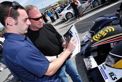 Simon Pagenaud signs an autograph