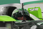 Ernesto Viso, HVM Racing holds an unbrella as the rain came