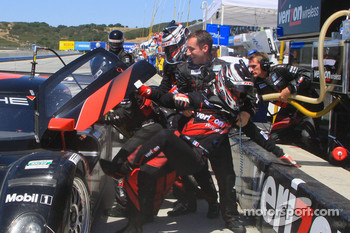 Romain Dumas is pulled out of the car by crew