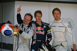 Sebastian Vettel, Red Bull Racing gets pole position, Jenson Button, Brawn GP 2nd and Rubens Barrichello, Brawn GP 3rd