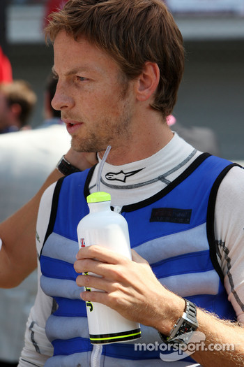 Jenson Button, Brawn GP, in a jacket designed to keep him cool before the race