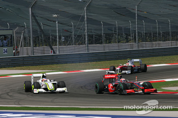 Heikki Kovalainen, McLaren Mercedes and Rubens Barrichello, Brawn GP