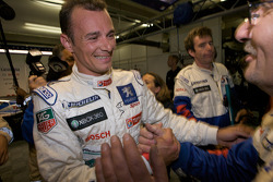 Pole winner Stéphane Sarrazin celebrates with Team Peugeot Total team members