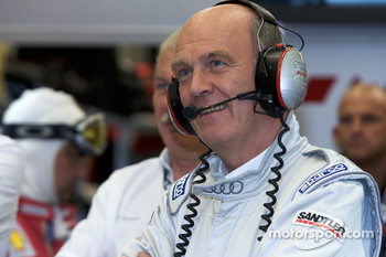 Dr. Wolfgang Ullrich and Audi Sport team members smile as Stéphane Sarrazin fails on his first attempt to beat Allan McNish's pole