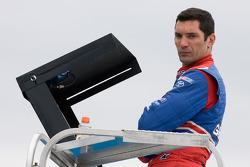 Max Papis waits atop his hauler