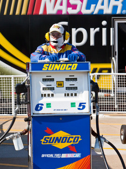 Sunoco gas man waits for the end of practice