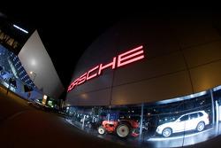 The Porsche Museum and the Porsche dealership on Porscheplatz by night