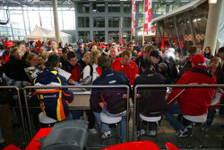 Romain Grosjean, Giedo Van der Garde, Andreas Zuber and Nico Hulkenberg sign autographs for fans during the GP2 signing session