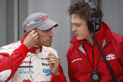 Pastor Maldonado talks with his engineer